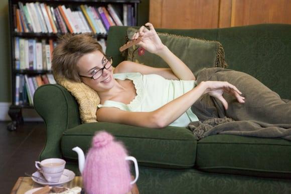 bigstock-Woman-Eating-Chocolate-On-Sofa-3916236