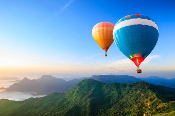 bigstock-Colorful-Hot-air-Balloons-Flyi-39426865