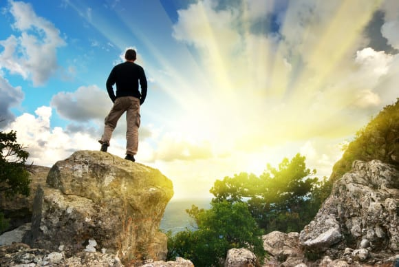 bigstock-Man-on-top-of-mountain-Concep-18659780
