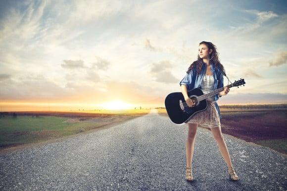 bigstock-beautiful-woman-with-a-guitar--47591341