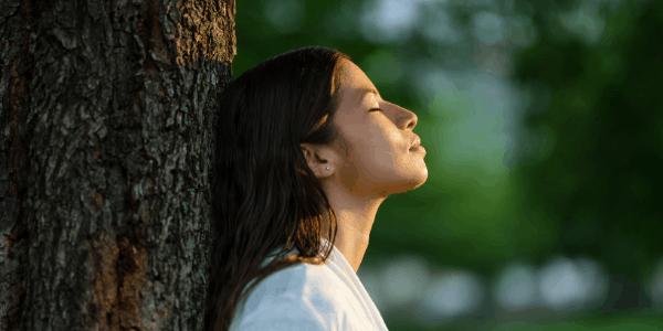 woman-tree-end-procrastinating