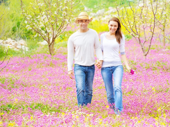 bigstock-Two-cheerful-lovers-walking-in-45727459