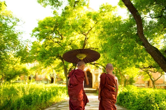 bigstock-Two-little-Buddhist-monks-walk-47042140