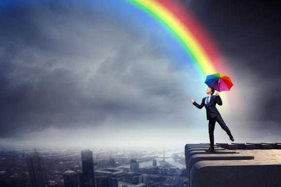 bigstock-Businessman-with-umbrella-atop-46531618