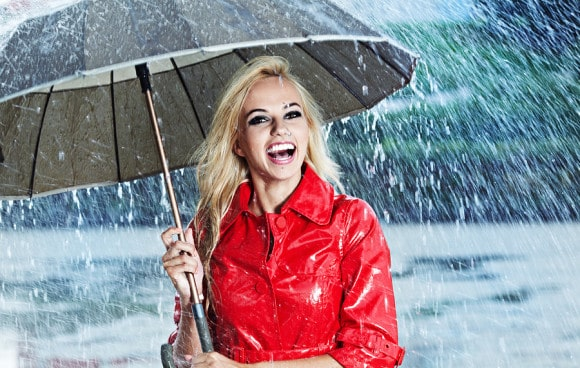 bigstock-Woman-in-raincoat-smiling-as-s-35505551