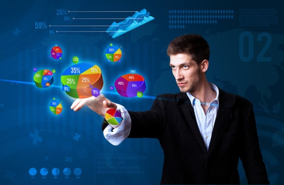 bigstock-Businessman-pressing-pie-chart-25559498