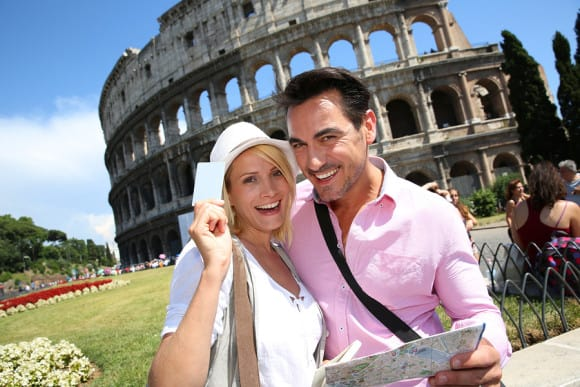 bigstock-Tourists-holding-visitor-s-mus-47729197