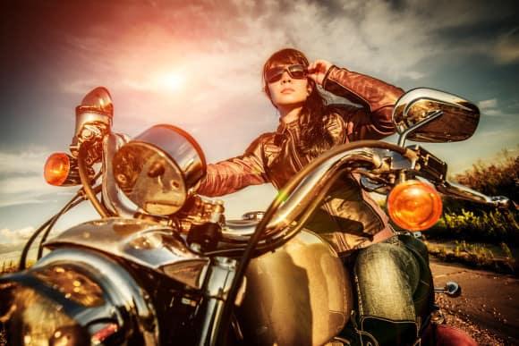 bigstock-Biker-girl-in-a-leather-jacket-50867054