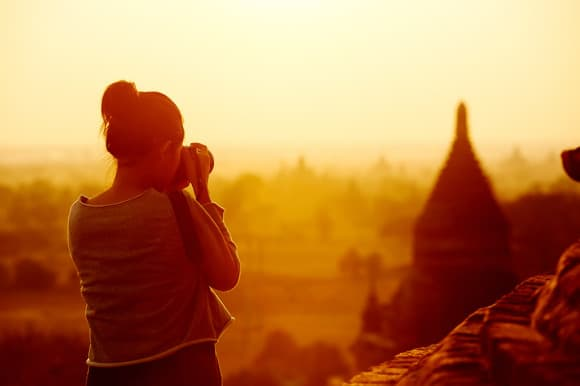female traveler photographing temples at Bagan Myanmar Asia at s