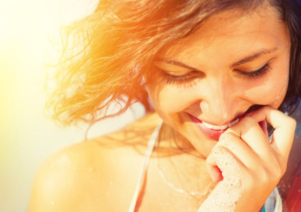Beauty Sunshine Girl Portrait. Happy Woman Smiling and looking D