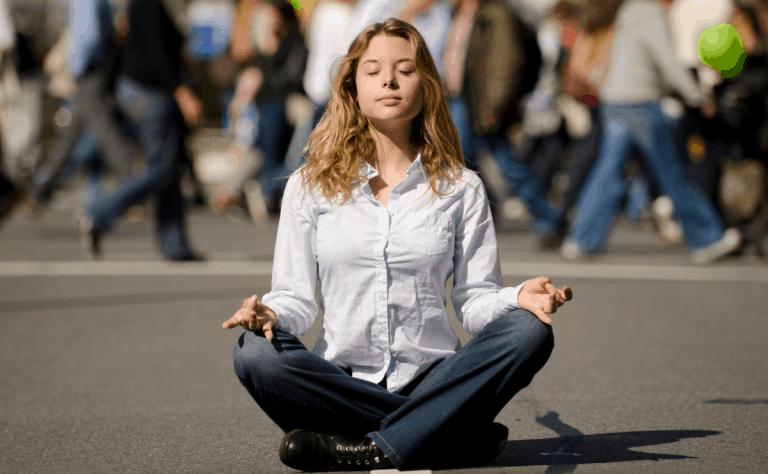 meditating-busy-street-more-stillness