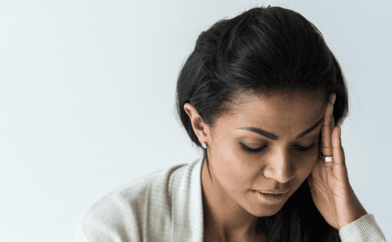 woman-holding-head-feeling-toxic-guilt